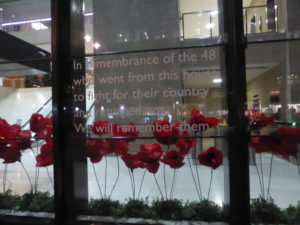 Remembrance poppies in the front window of Coutts