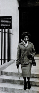 A black and white photograph showing Jabavu leaving The New Strand offices in London