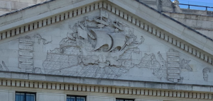 The Bush House rear facade depicting a ship connecting the U.S. and U.K.