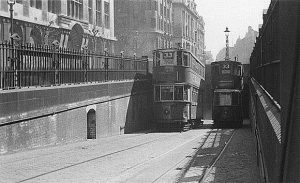 Two 33 trams passing one another at the entrance to Kingsway Tram Tunnel.
