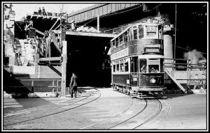 A 33 tram exiting onto the Embankment from a new double-decker tunnel.