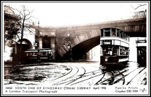 A single-decker tram exiting the Kingsway Tram Tunnel onto the Embankment (left) before the tunnel was expanded in 1939.