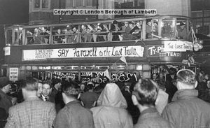 A crowd of Londoners saying their farewells to the last tram on the 33 route.